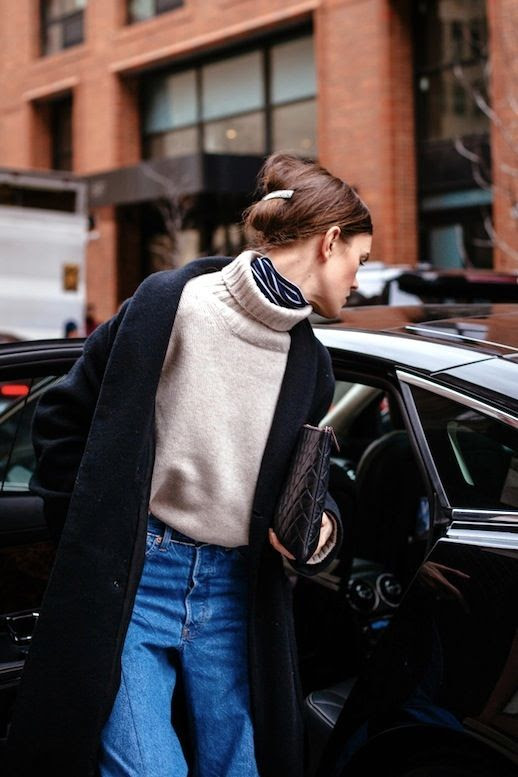 Le Fashion Blog Fall Street Style Undo Hair Barrette Clip Layers Chunky Turtleneck Sweater Layered Over Turtleneck Shirt Black Clutch Denim Via WWD