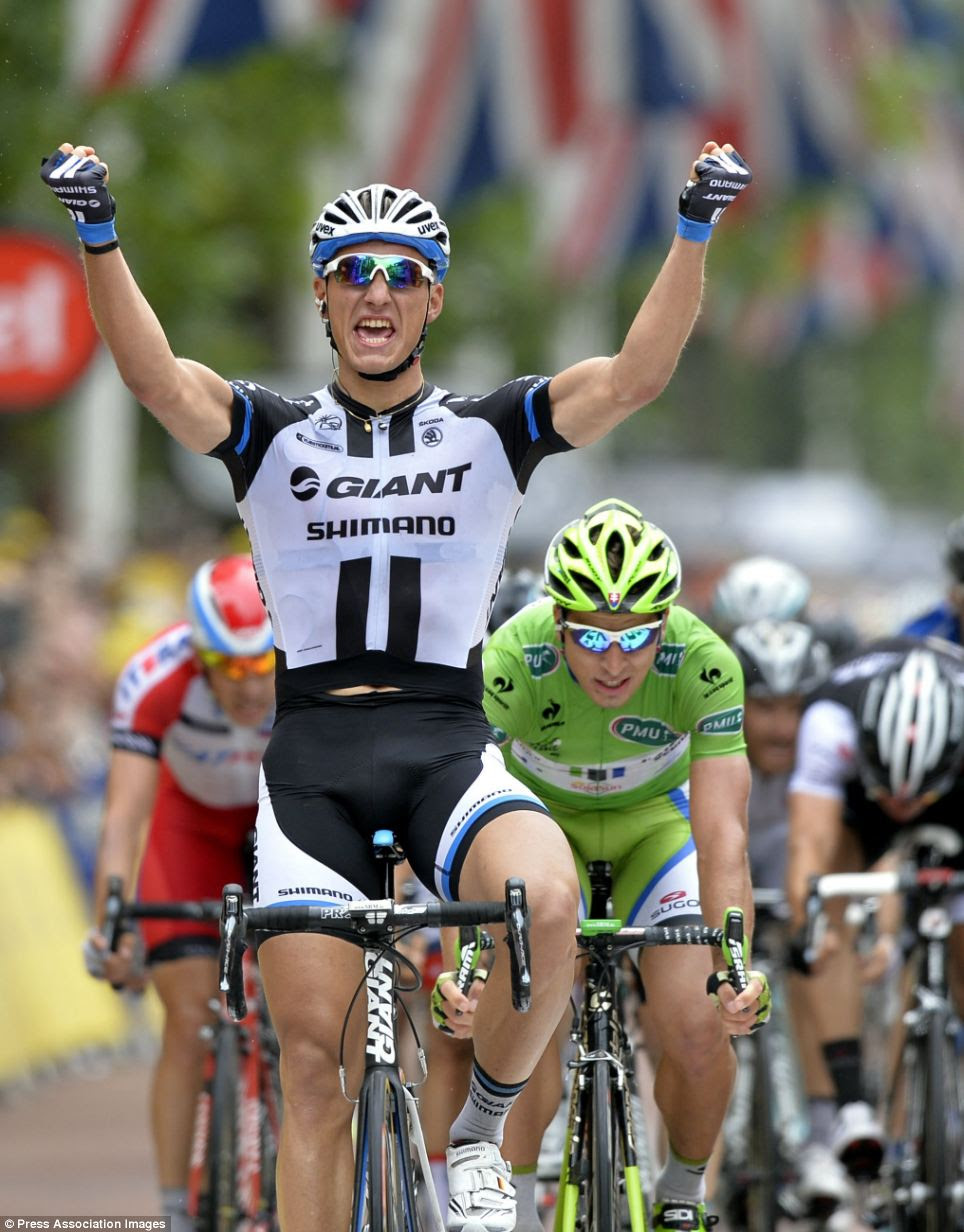 Victory: Marcel Kittel celebrates after winning stage three of the 101st edition of the Tour de France
