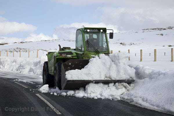06D-4161 Digging out part of the B6277 road.