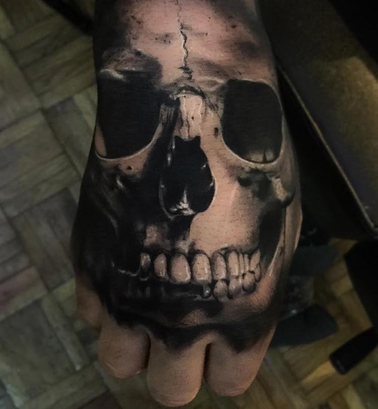 Realistic Skull Hand Tattoo Best Tattoo Design Ideas