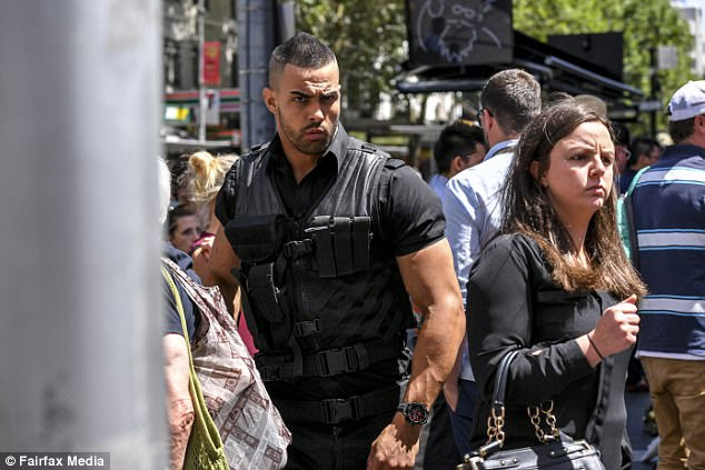 Image result for Unlicensed security guard who carried gun to Bourke Street memorial to be charged