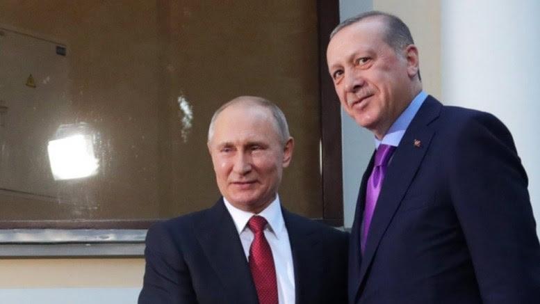 File Photo: Russian President Vladimir Putin (L) shakes hands with Turkish President Recep Tayyip Erdogan (R) during a meeting in the Black sea resort of Sochi, Russia. EPA, MICHAEL KLIMENTYEV, SPUTNIK,  KREMLIN POOL MANDATORY CREDIT