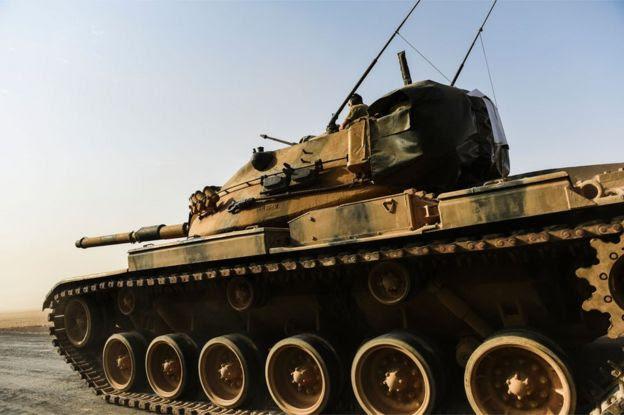 A Turkish tank moves towards the Syrian border at Karkamis, 24 August