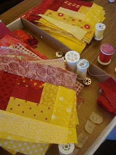 Red and yellow quilt blocks. I love the log cabin pattern.