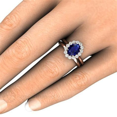 Blue Sapphire and Diamond Wedding Ring Oval Cut Halo