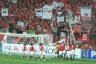 Urawa players celebratew with fans