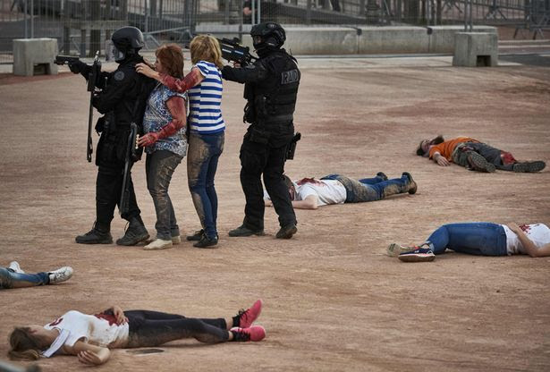 Police forces take part in a mock suicide attack exercise as part of security measures for the upcoming Euro 2016 football championship, at the fan zone in Lyon