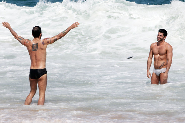 Fashion mogul Marc Jacobs makes the most out of his Brazilian vacation with a trip to the beach with boyfriend Harry Louis on Ipanema beach.  When not splashing around in the water, the pair covered up with sunscreen and sipped on some coconuts.