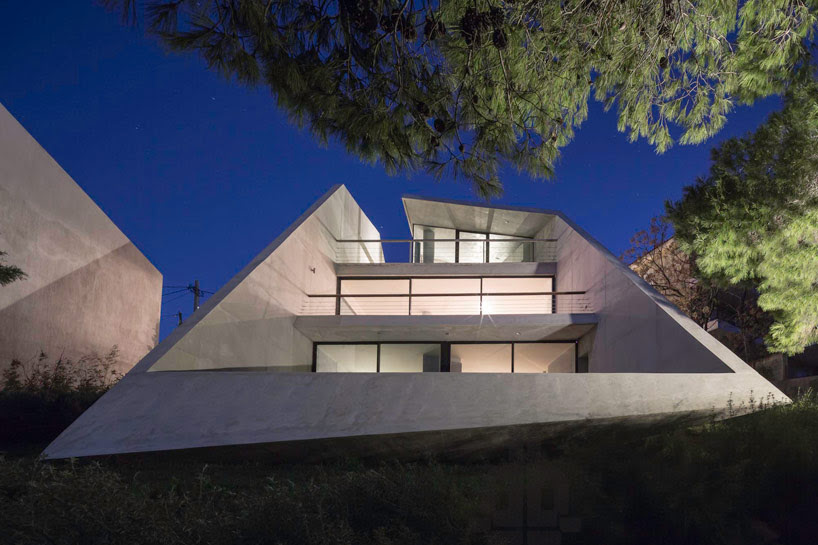 tense architecture network embeds home into a greek hill