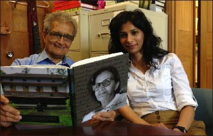 Gita Gopinath is seen with first Indian Nobel Laureate Dr. Amartya Sen. Dr. Sen is seen reading a book written by Gita's grandmother about their family.