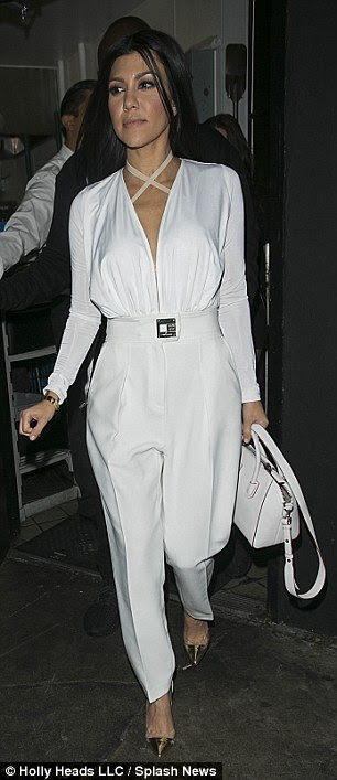 Chic:Kourtney, who is the oldest member of the Kardashian clan, showed off her incredibly petite figure in the high-fashion look which saw the top boast a plunging neckline