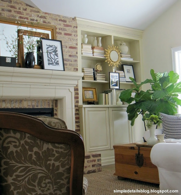 Simple Details: our spring mantel and bookcases with books turned backwards