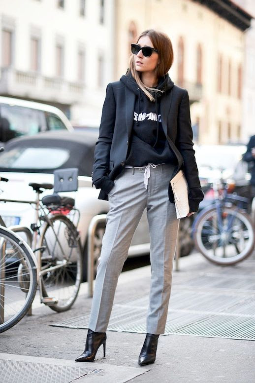 Le Fashion Blog Street Style Mfw Oversized Blazer Graphic Hoodie White Clutch Grey Pants Leather Pointed Toe Ankle Boots Via Popsugar