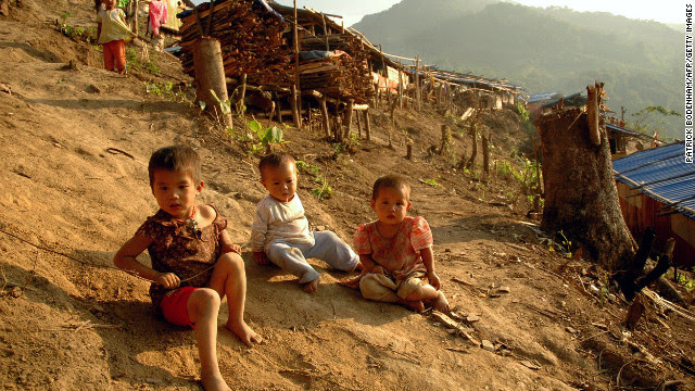 Kachin children play outside wooden shacks at the N-Hkawng Pa Internally Displaced People's (IDP) camp outside Mai Ja Yang, May 2012.