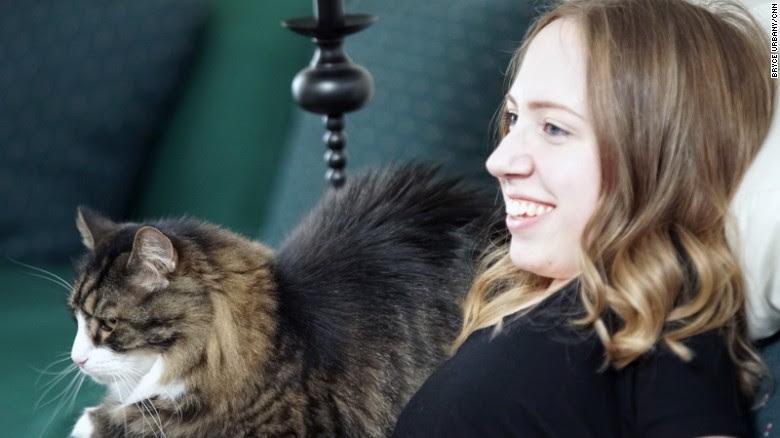 Prancer, Jasmin's Maine Coon cat, makes her smile.