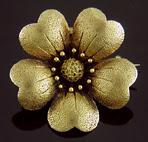 14kt gold anemone brooch. (J2291)