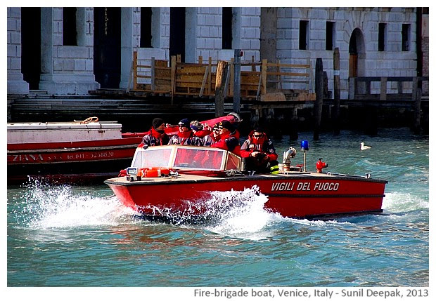 Venice walking tour, fire brigade boat, Italy - images by Sunil Deepak