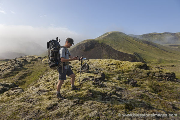06D-0522 Hiker Using Smartphone in Iceland