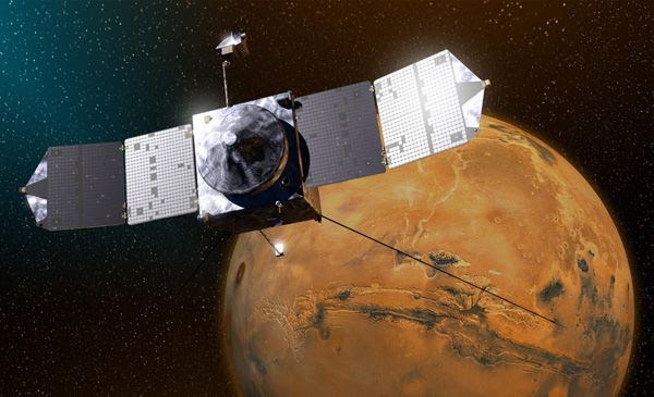 A composite image showing NASA's MAVEN spacecraft approaching Mars.