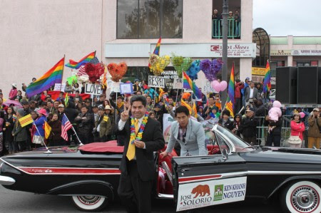 Rancho Santiago Community College District Trustee Jose Solorio exits his parade vehicle to join the peaceful demonstration by supporters of the Partnership of Vietnamese LGBT Organizations which was excluded from the 2013 Tet Parade. (Photo: Chris Prevatt)
