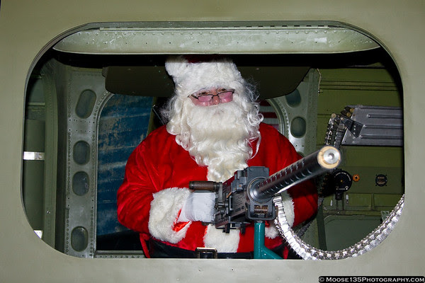 November 27 - You better be good...or else!  Santa visits the American Airpower Museum.