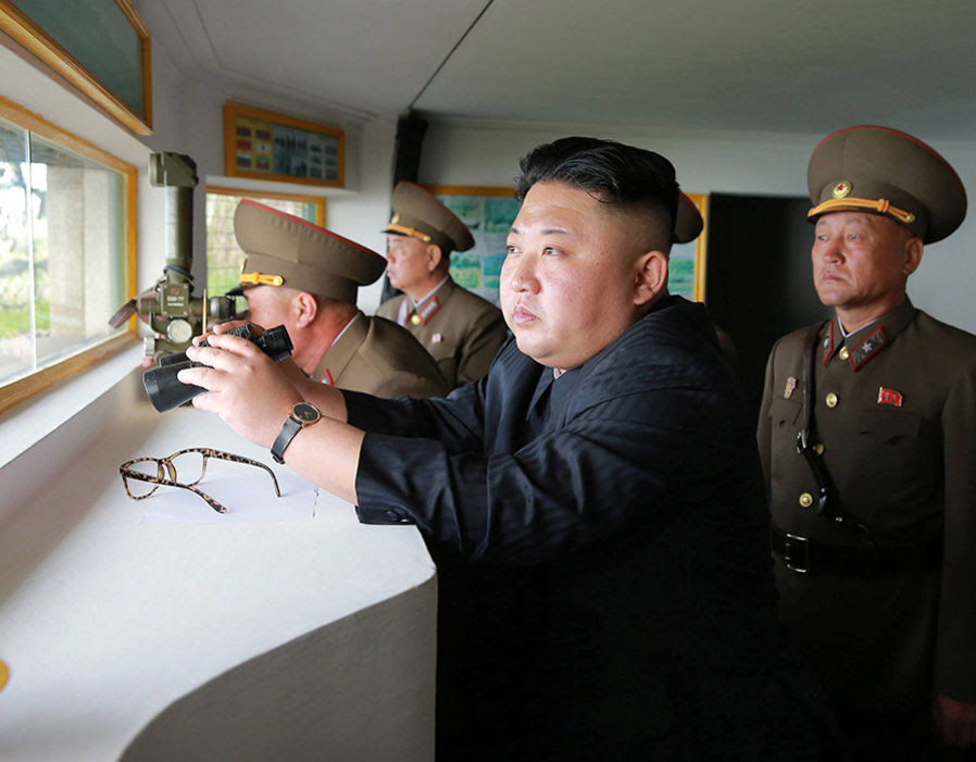 North Korean leader Kim Jong Un inspects the defence detachment on Jangjae Islet and the Hero Defence Detachment on Mu Islet located in the southernmost part of the waters off the southwest front, in this undated photo released by North Korea's KCNA