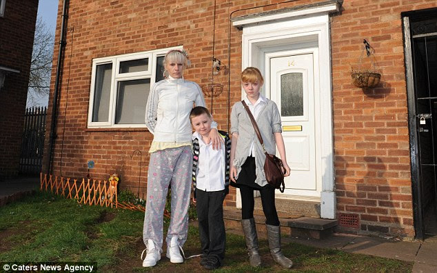 Spooky: Lisa Manning is shown with children Jaydon and Ellie outside their house near Coventry which they believe is haunted