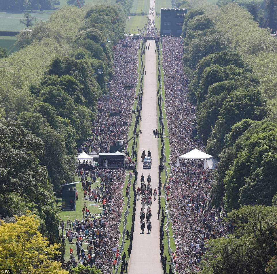An aerial shot shows the massive crowds which lined the Long Walk east of Windsor Castle for the procession