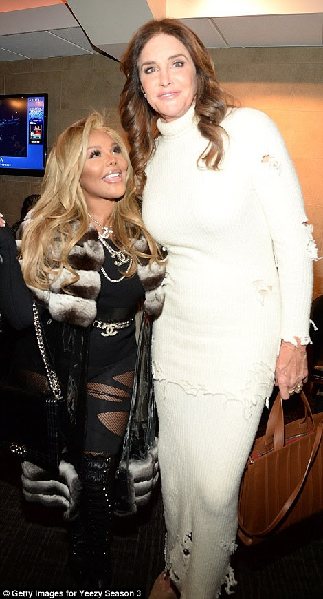 Girl talk: Caitlyn chatted with rapper Lil' Kim, who wore a long fur and fishnet stockings