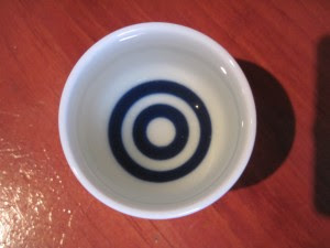 Look into the sake cup. You are getting sleepy. Copyright Deborah Abrams Kaplan