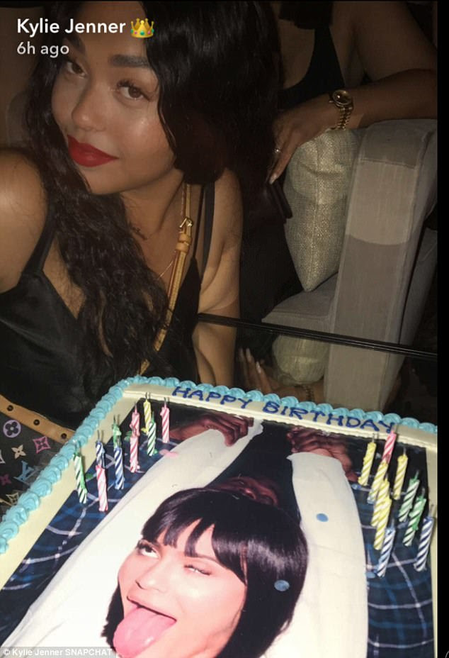 Cheeky: Her best friend Jordyn Woods posed alongside her cake, which featured her face with her tongue sticking out