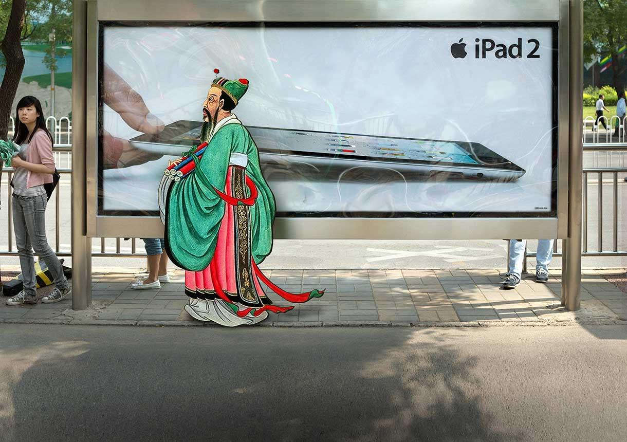 Confucius walking past modern ipad ad