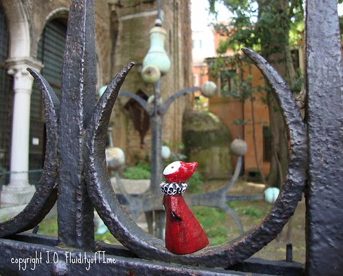 Venice Poppet in courtyard with metal cross