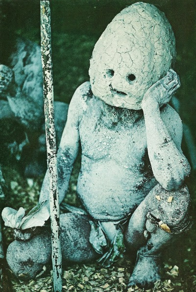 Ghoulish mud man from the Asaro River Valley, New Guinea, dons a helmet of dried clay and smears mud over his body to portray an evil spirit National Geographic | July 1969