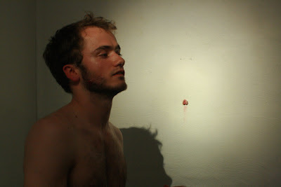 Performance artist Adrian Parsons with his foreskin hanging on the wall
