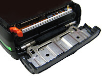 Sony Ericsson K850i - slide-out door that allows access to the battery and the SIM card.