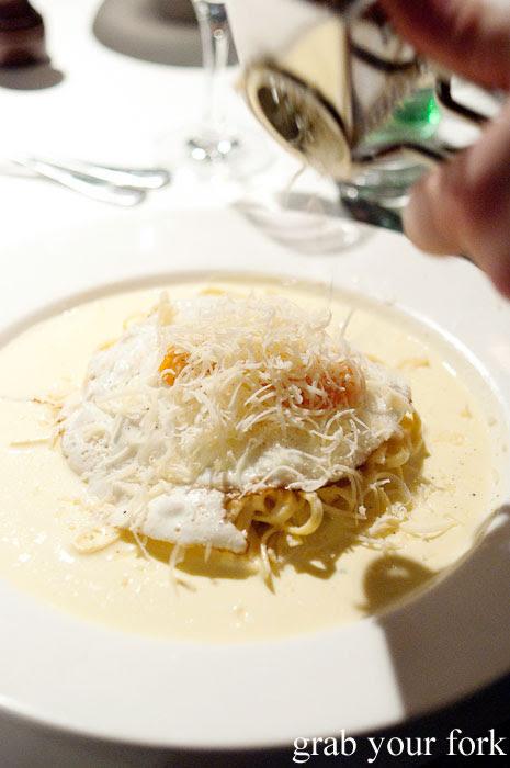 Fresh parmesan grated over the truffle egg pasta at Buon Ricordo, Paddington