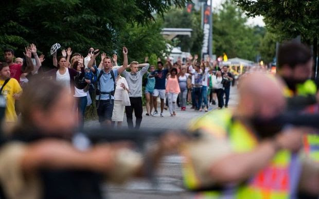 Police evacuate people from the shopping mall in Munich.