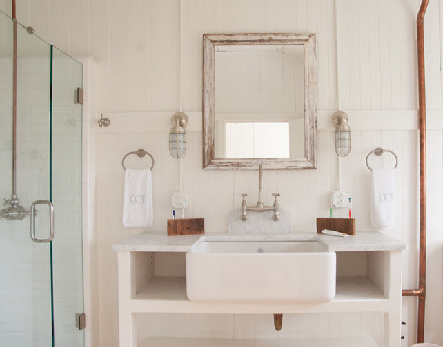 Bathroom. The vanity was custom made and the sink used was a porcelain farmhouse sink. The lights are from Urban Archaeology. allee architecture + design, llc