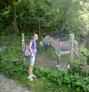 Colleen next to the burros