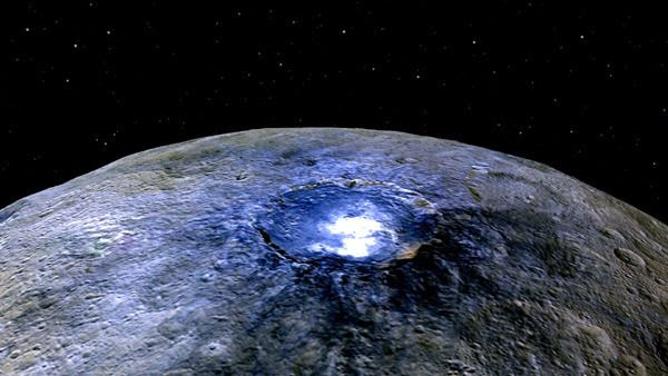 A false-color image taken by NASA's Dawn spacecraft of the Occator crater on dwarf planet Ceres.