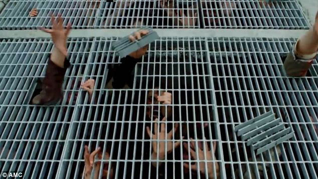 Hungry: A hoard of zombies were crammed beneath a grate that they could reach their arms through