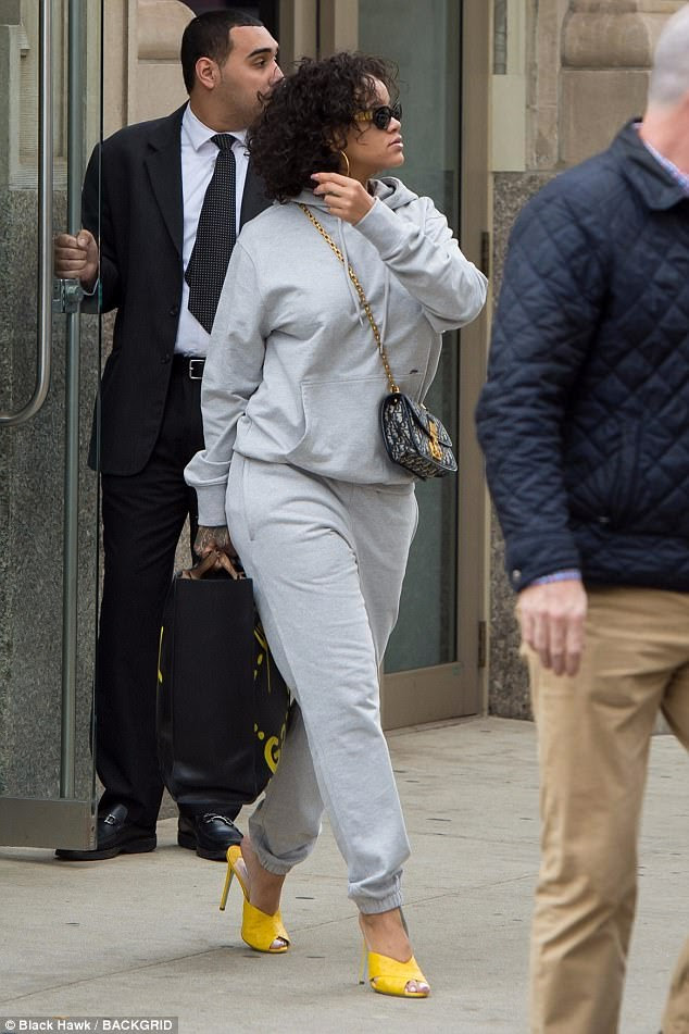 Making the sidewalk her runway:The 29-year-old singer glammed up her sweatsuit with bold yellow heels and two luxury handbags