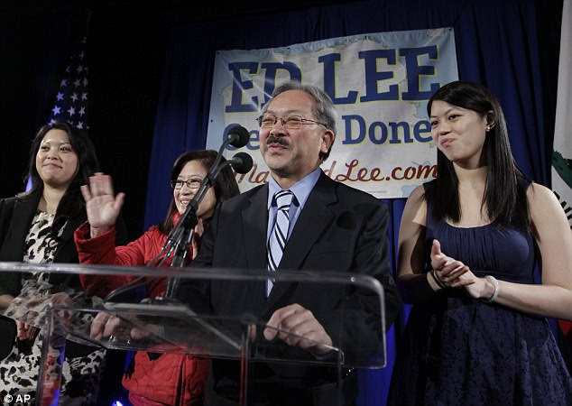 Lee is pictured above with his wife Anita, left, and daughters Tania, left, and Brianna, right, on November 8, 2011 - the day he won his first mayoral election