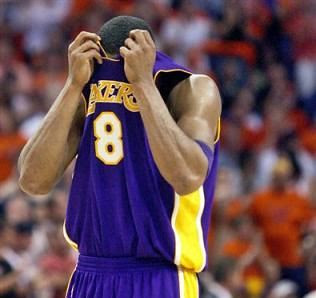 Kobe hides face