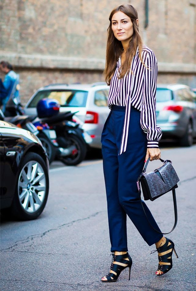 Pair tailored pants with a striped blouse and textured handbag for an office look that's sure to stand out.