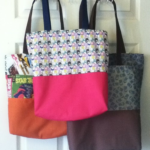 I finished some totes today. They'll hopefully be in my shop by the end of the week.  www.sparklegirl.etsy.com