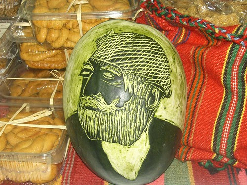 face of traditional cretan man carved in a watermelon