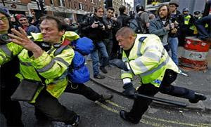 British police chase demonstrators who were protesting against the budget cuts stemming from the world economic crisis impacting all the capitalist states. Britain is one of the imperialist states bombing Libya. by Pan-African News Wire File Photos