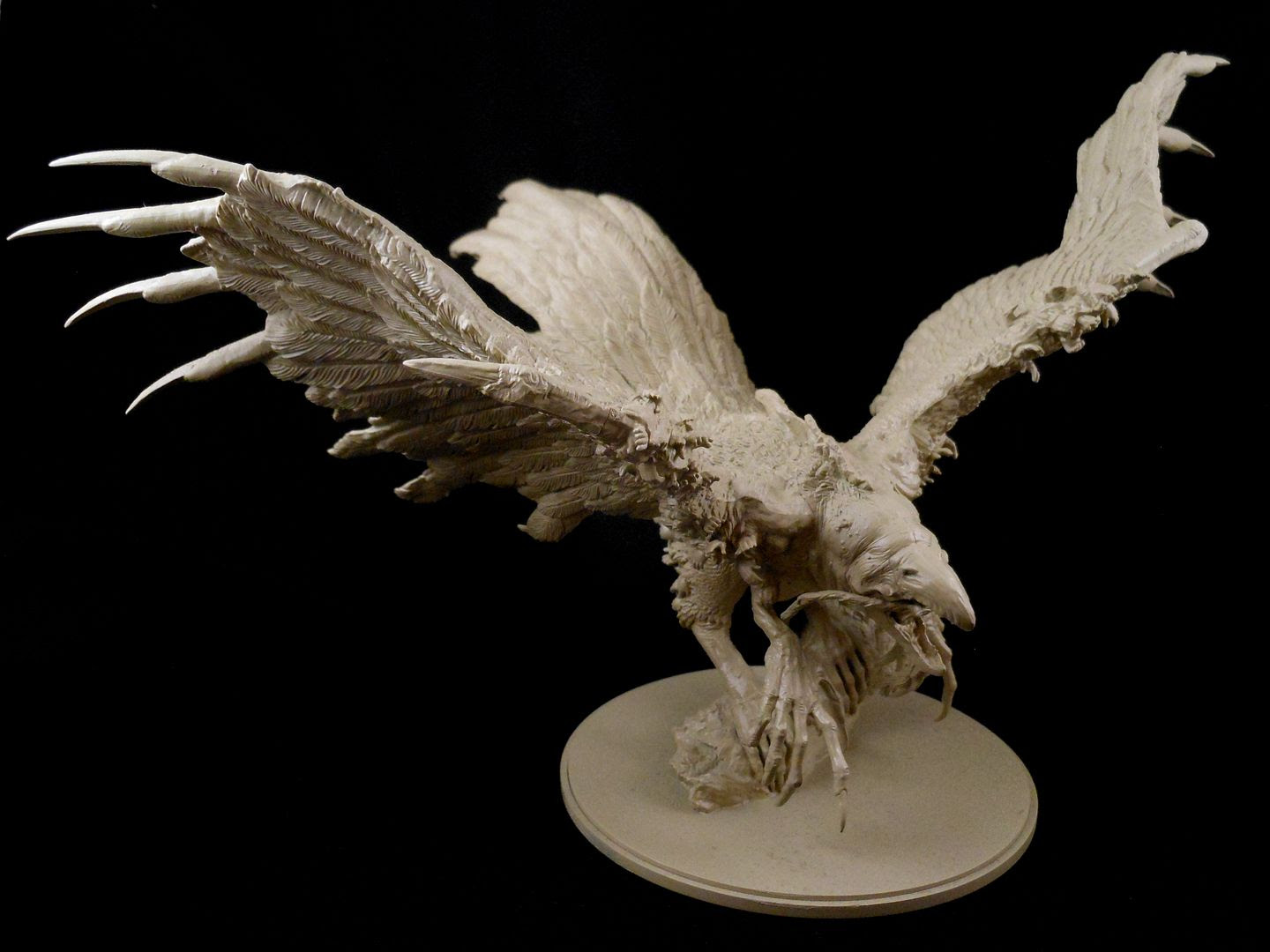 The phoenix from Kingdom Death: Monster, primed with skeleton bone.